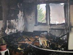 Požár bytu ve druhém patře bytového domu na ulici Družstevní ve Vsetíně.