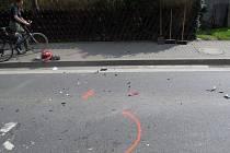 Místo střetu motocyklu a osobního vozu v Jablůnce na Vsetínsku, čtvrtek 18. září 2014.