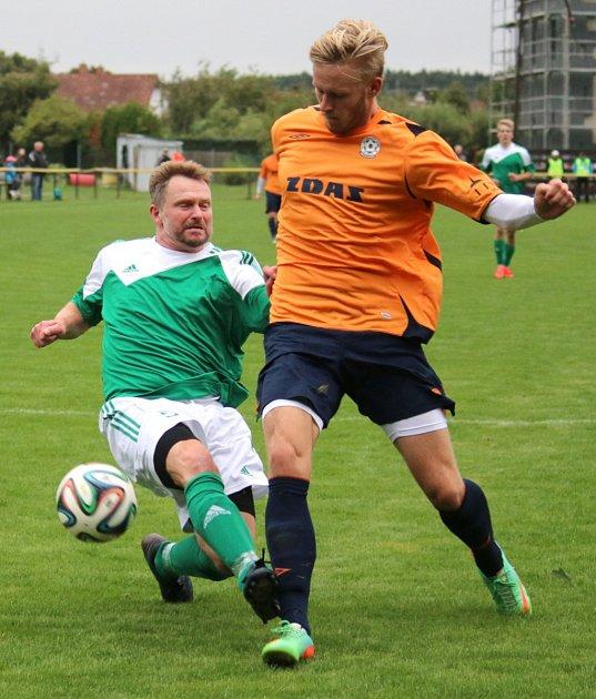 Martin Slavík (v zeleném) ve ždírecké kabině povýšil z hráče na trenéra.