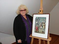 Vernisáž. Iva Hüttnerová přijela na vernisáž výstavy svých obrazů do Světlé. Ke koupi byly nejen grafiky Ivy Hüttnerové, ale také její knihy nebo kalendáře, které si lidé nechali od autorky podepsat.