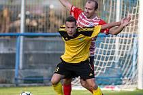 První gól v tomto divizním ročníku by Matěj Vopršal (ve žlutém dresu) rád vstřelil v neděli proti Havlíčkovu Brodu.