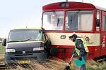 Srážka na železničním přejezdu u Rozhovic.