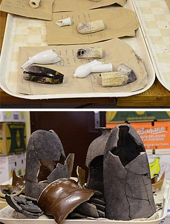 Úlomky dýmek a pod nimi zbytky nádob pro pěstování chřestu