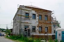 Polyfunkční dům v Dřevěnici.