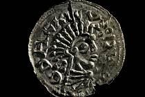 Denár Oldřicha I. (1012-1033, 1034) z hrobu číslo 78, pohřebiště v blízkosti kostela svatého  Jiří, Kostoľany pod Tribečom, Slovensko.