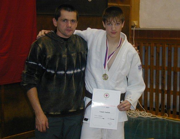 Tomáš Vaníček s trenérem, otcem Luďkem.