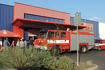 Zásah hasičů v obchodním domě.