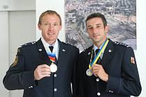 Úspěšní hasiči na jičínské radnici, přišli i s medailemi, zleva Tomáš Mintál.