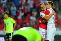 Fotbalové utkání Fortuna ligy mezi celky SK Slavia Praha  a MFK Karviná 28. července v Praze. Stanislav Tecl a Milan Škoda se radují po vítězství nad Karvinou.