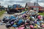 Odpadky v popelářském voze začaly hořet v jihlavské Šlezingerově ulici.