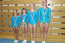 Gymnastky náchodského Sokola se ze Šumperka vracely s medailemi i poháry za přední umístění.