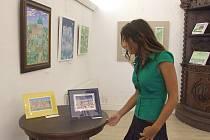 Výstava maleb nese název Romantické hrady a zámky a všelijaké jinačí pěknůstky.
