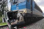"""Popis fotky: Nehoda na přejezdu v Borohrádku - Dva mrtvé si vyžádal 21. července 2020 střet vlaku s osobním automobilem na nechráněném železničním přejezdu na okraji Borohrádku na Rychnovsku.<body xmlns=""""http://newsml.ctk.cz/ns/ctkxhtml.xsd""""><p>    Borohr"""