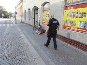 Opilec ležící na ulici