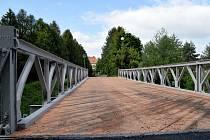 Práce na opravě mostu přes řeku Jihlavu v Poušově v těchto dnech finišují.