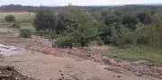 Čikov - pohled na zavážený pozemek přebytečnou zeminou z rekonstruované D1.