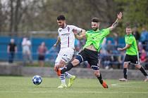 V kritické situaci se ocitli fotbalisté Nového Města na Moravě (v zeleném dresu Lukáš Wolker) dvě kola před koncem letošního ročníku MSFL.