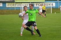 Jen jediný bod vytěžili ze tří domácích utkání letošního ročníku třetí ligy fotbalisté novoměstské Vrchoviny (v zeleném dresu Michal Skalník).