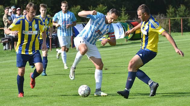 Kádr fotbalistů Herálce (v modrobílém) se možná dočká nečekaného, ale o to potřebnějšího rozšíření o některé hráče, kteří již před časem v týmu skončili.
