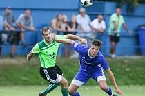 Fotbalisté Nového Města na Moravě (v zeleném dresu).