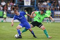 Důležité body v sobotu z Rýmařova dovezli fotbalisté Nového Města (v zeleném Lukáš Michal).