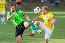 Už do čtvrtého ročníku v Moravskoslezské fotbalové lize vede Lukáš Michal (v zeleném dresu) hráče Nového Města jako kapitán.