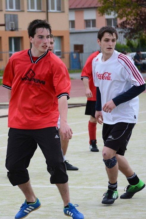 Nejrychlejší gól na turnaji vstřelil Jakub Rousek (v červeném) z Psycha.