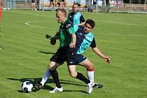 Z okresního fotbalového derby krajského přeboru Ostrá - Polaban Nymburk (1:1)