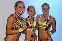 MISTRYNĚ SVĚTA. Dominika Herzánová z Poděbrad (vlevo), Andrea Švihálková z Kladna a Marika Podlucká z Hradce Králové mají zlaté medaile.