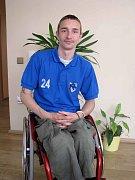 Vozíčkář Zdeněk Šafránek ve svém domě v Pátku.