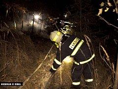 Noční požár lesa nad zámkem v Náměšti na Hané
