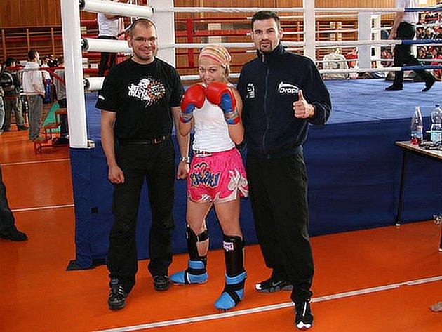 Tereza Sychrová s trenérem Michalem Prstekem (vpravo).