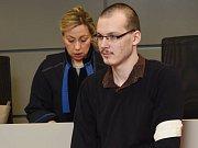 Martin Smékal u krajského soudu v Olomouci. Podle obžaloby se měl pokusit zavraždit svého soka