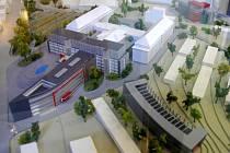 Model centra BIOMEDREG - vpravo dole - a dostavby Teoretických ústavů - vlevo