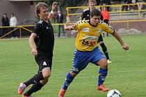 Juniorka HFK (v černém) proti Litovli