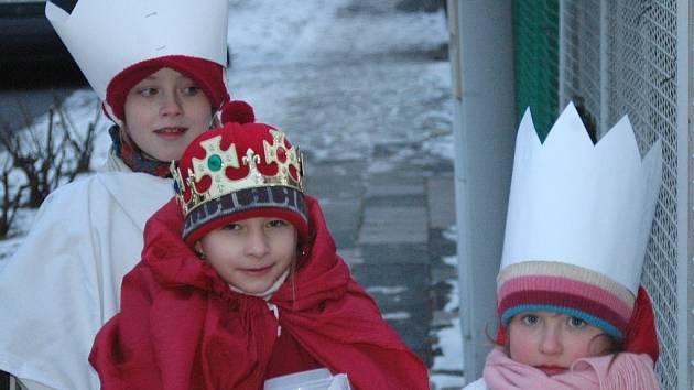 Tři králové s pokladničkou.