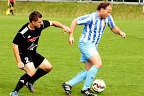 Fotbalisté HFK Olomouc (v černé) proti Prostějovu. Ilustrační foto