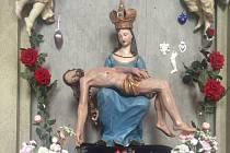 Zrestaurovaná socha Panny Marie.
