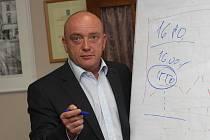 Michal Kraus ve své kanceláři
