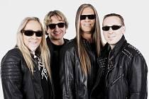 Fany Veselák (baskytara), Dan Dobiáš (kytara, zpěv), Karel Paul (kytara, zpěv) a Pavel Černý (bicí)