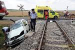Srážka motorového vlaku a osobního auta u Kamenného Újezdu, 18. 7. 2019.