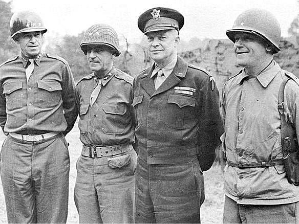 Zprava: velitel VII. sboru generálmajor Lawton J. Collins, velitel všech spojeneckých sil generál Dwight D. Eisenhower,  velitel V. sboru generálmajor Leonard T.Gerow,  velitel 1. americké armády generálporučík Omar N. Bradley