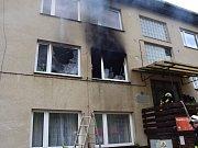 Požár v bytovce pod přehradou Orlík.