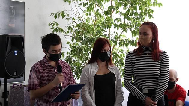 Slavnostní závěrečná prezentace projektu Příběhy našich sousedů v sále Státní okresního archivu Rakovník.
