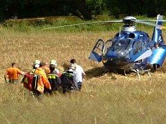 Záchrana zraněné ženy