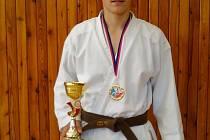 Dominik Fulnek s pohárem za první místo