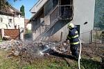 Majitel zapálil odpad