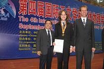 Stanislav Fořt (uprostřed) na olympiádě v Pekingu.