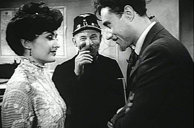 František Hanus jako malíř Petr (vpravo) se do pěvkyně zamiluje. Přihlíží drážní zaměstnanec Trnka vpodání Františka Kováříka.