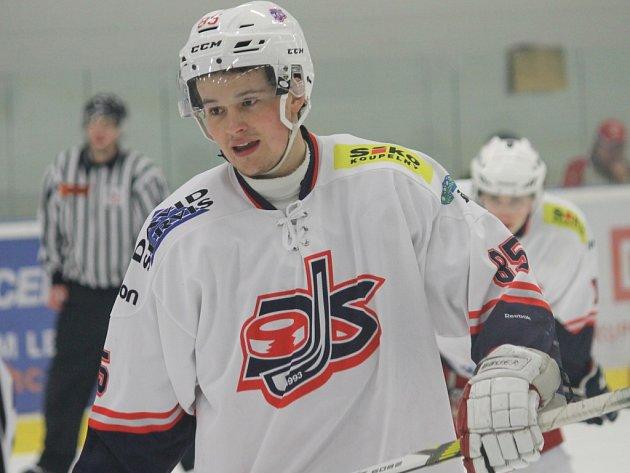 Hokejista David servisu Jiří Bárta.